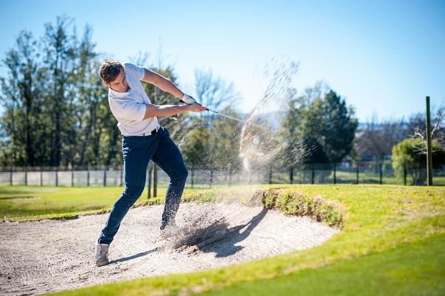 Image of Golfer Hitting out of a Zline Bunker
