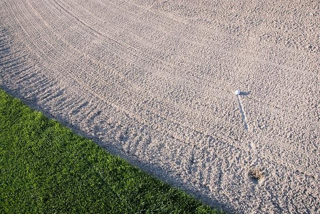 Image of Golfer Hitting out of Sloped Zline Bunker
