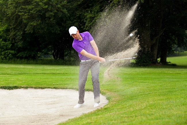 Image of Pro Golfer Hitting out of a Zline Bunker